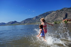 Children splashing in the water on a hot summers day, Osoyoos BC